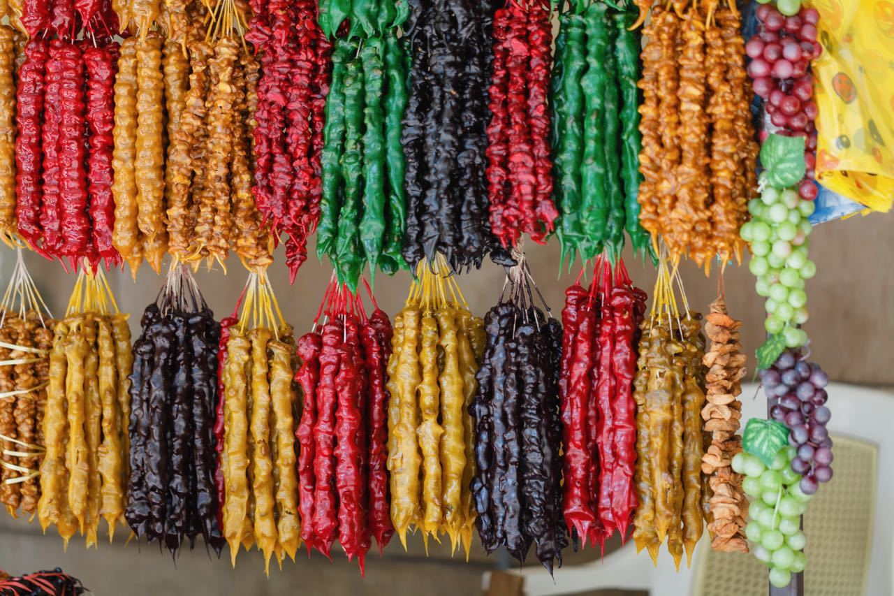 Top Things To Do In Tbilisi, Georgia - street stall with typical Georgian candy - Churchkhela and Georgian spices