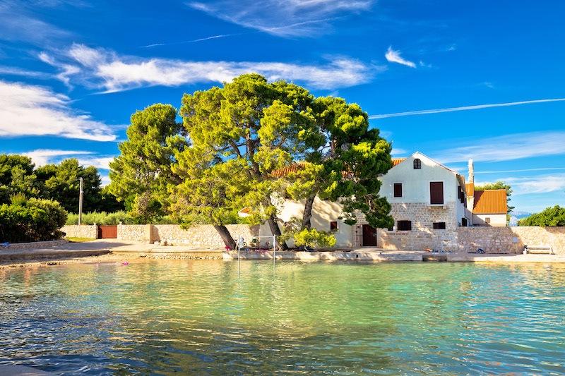 Zadar Bike Tours - Ugljan village idyllic island beach and old architecture