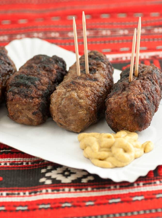 Meat rolls romanian mici mititei with mustard