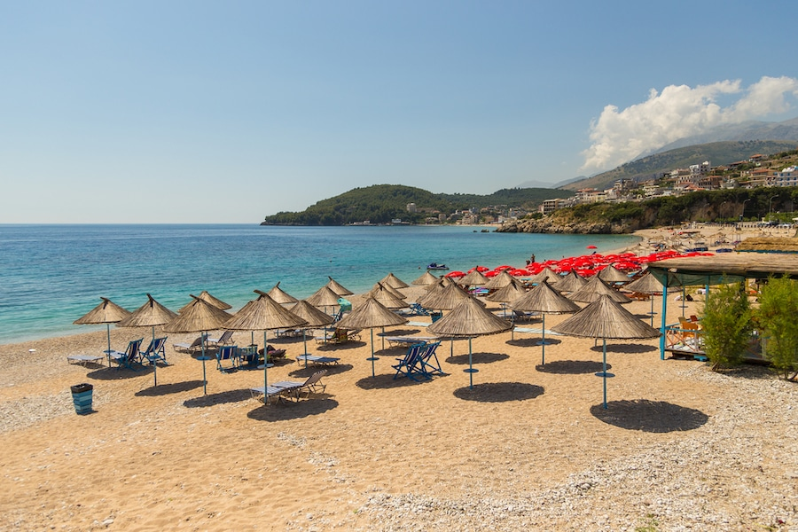 Things To Do In Himare, Albania - Sunbathers on the beach in Himare resort, Albania.
