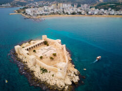 Best Island Of Turkey - Ancient fortress named Kizkalesi or Maiden Castle at mediterranean island aerial view. Kizkalesi, Mersin province, Turkey