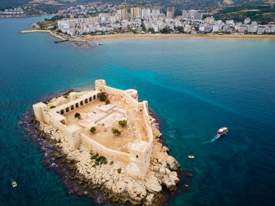 Best Island Of Turkey - Ancient fortress named Kizkalesi or Maiden Castle at mediterranean island aerial view. Kizkalesi, Mersin province, Turkey