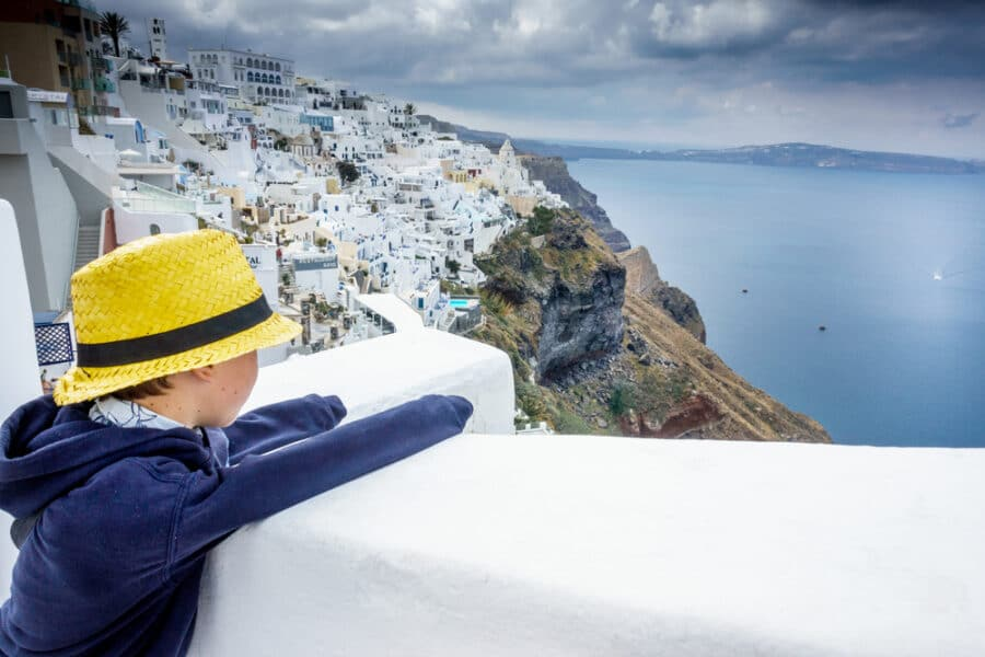 Little boy admiring Santorini With Kids, Greece