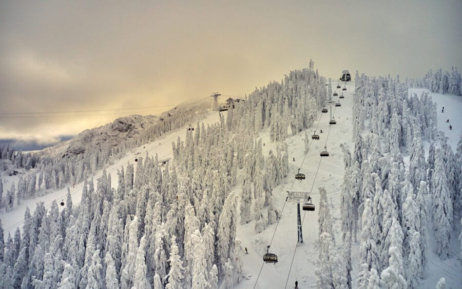 Winter in Romania - Aerial view over the spectacular ski slopes in the Carpathian Mountains