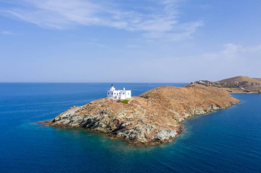 Greece, Kea Tzia island. Lighthouse and white St. Nicolas