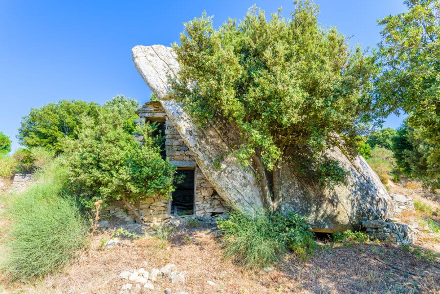 Ancient,Traditional,Stone,House,Ruin,Built,Under,A,Boulder,On
